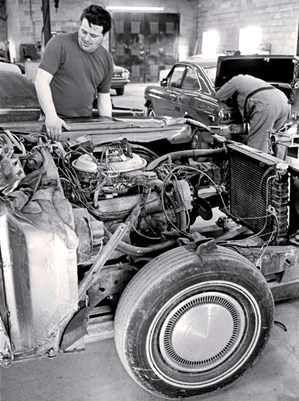 Vintage Shot of Body Shop Repairing Car